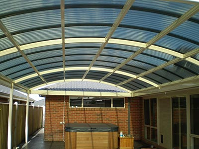 A curved patio roof over an outdoor structure can add style and interest