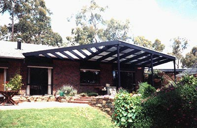 Adding a roof over an existing deck or building a new pergola with a roof is not as simple a question as you might think.